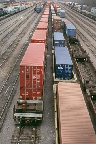 containers in well cars sit in Proviso Yard.